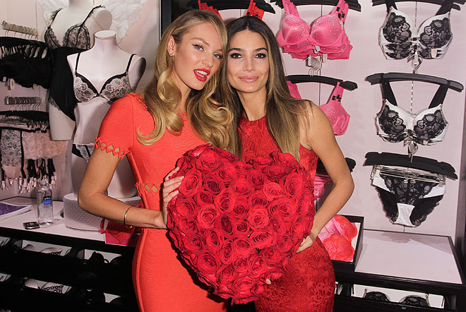 Victoria's Secret Angels Candice Swanepoel and Lily Aldridge pose at the retailer's Manhattan flagship store.