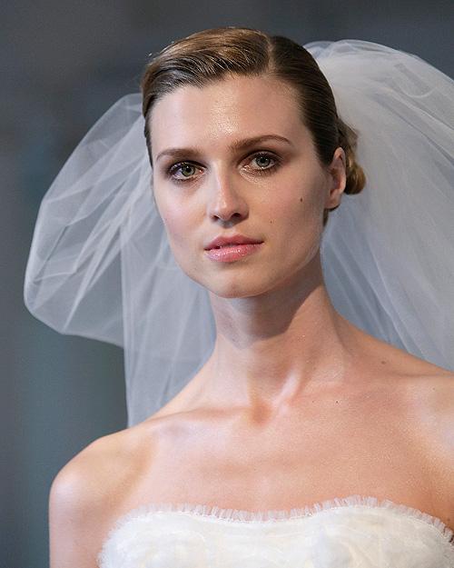 A model walks the runway at Marchesa's 2014 bridal show