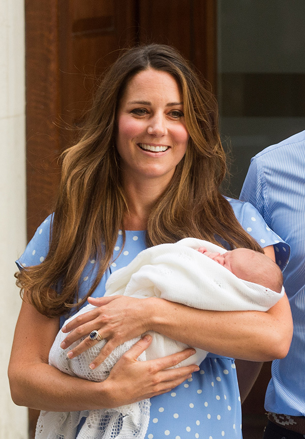Kate Middleton holds the Royal Baby while sporting her signature lush blowout.