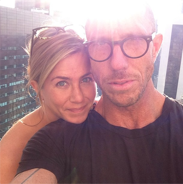 Jennifer Aniston poses without makeup with hair stylist Chris McMillan