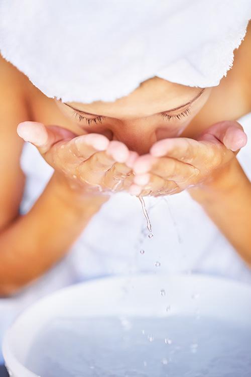 Woman washing face
