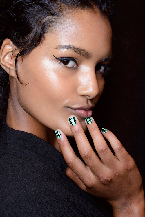 A model shows off her nail polish at Tracy Reese's S/S 2014 runway show